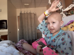cienna, a 7 year old battling cancer, practicies her pink ukulele